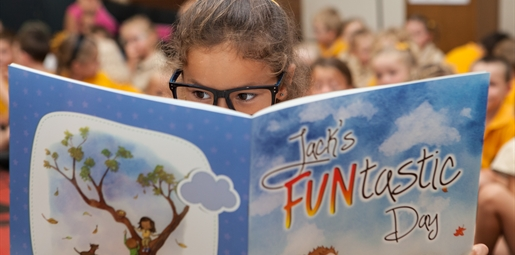 Girl reads Jack's FUNtastic Day