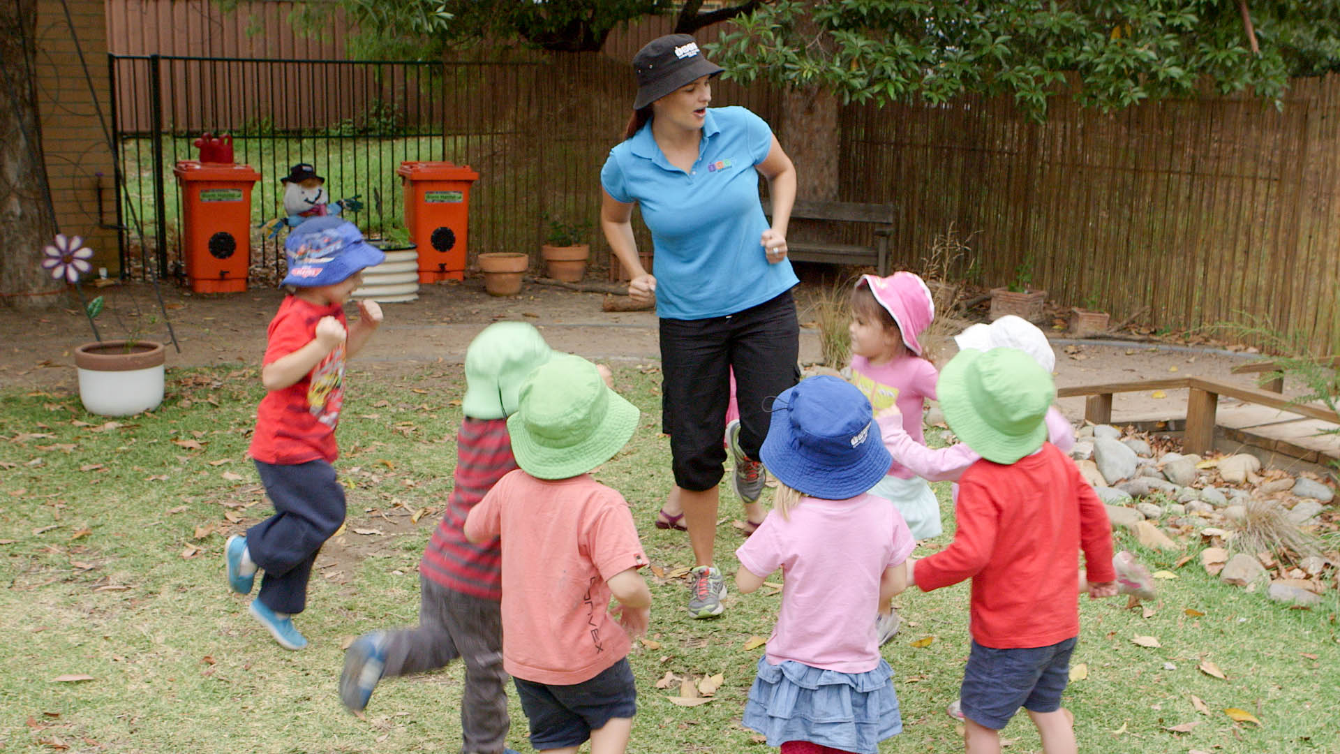 Educator teaches a group of children to hop