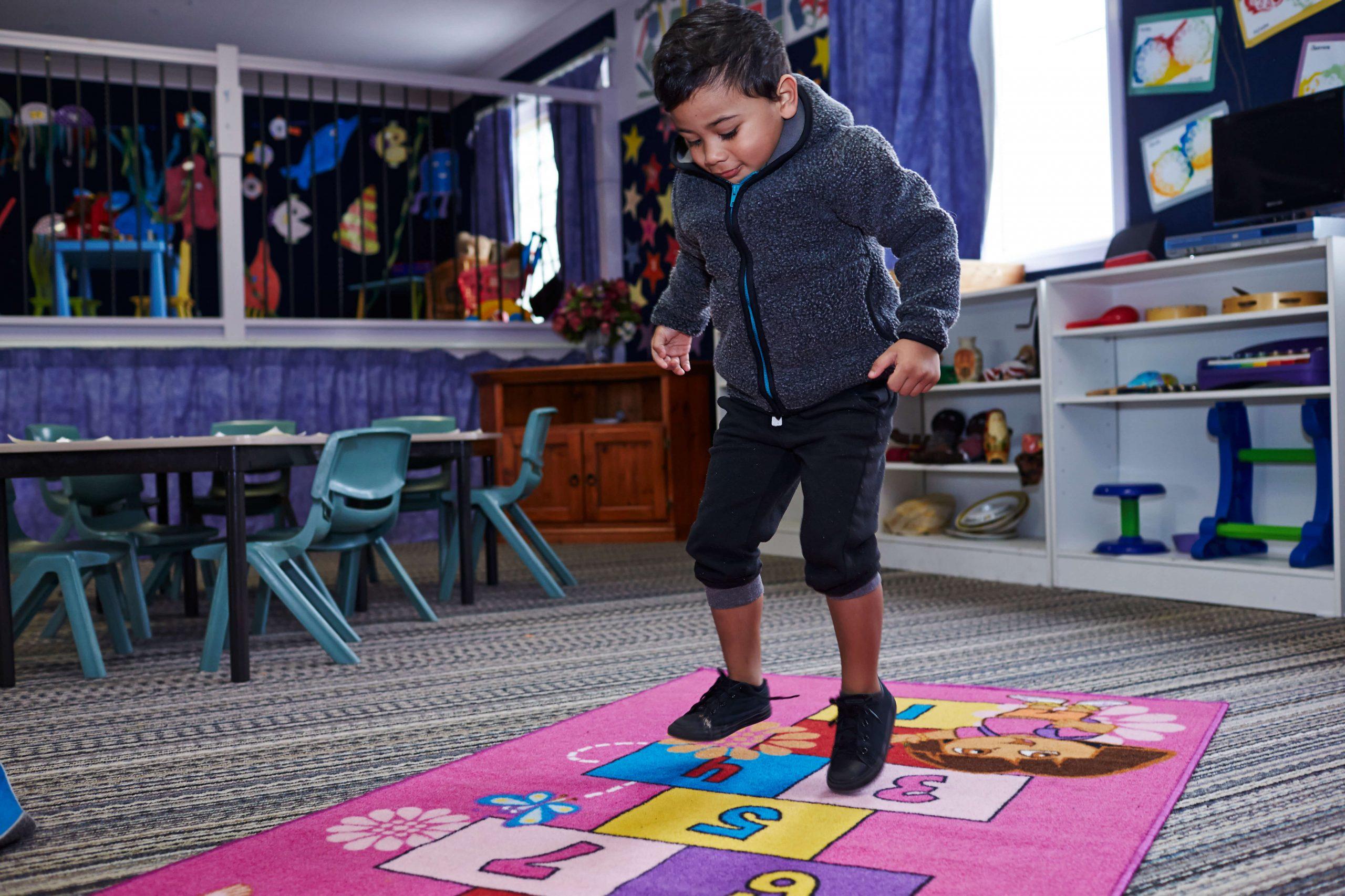 Boy doing hopscotch